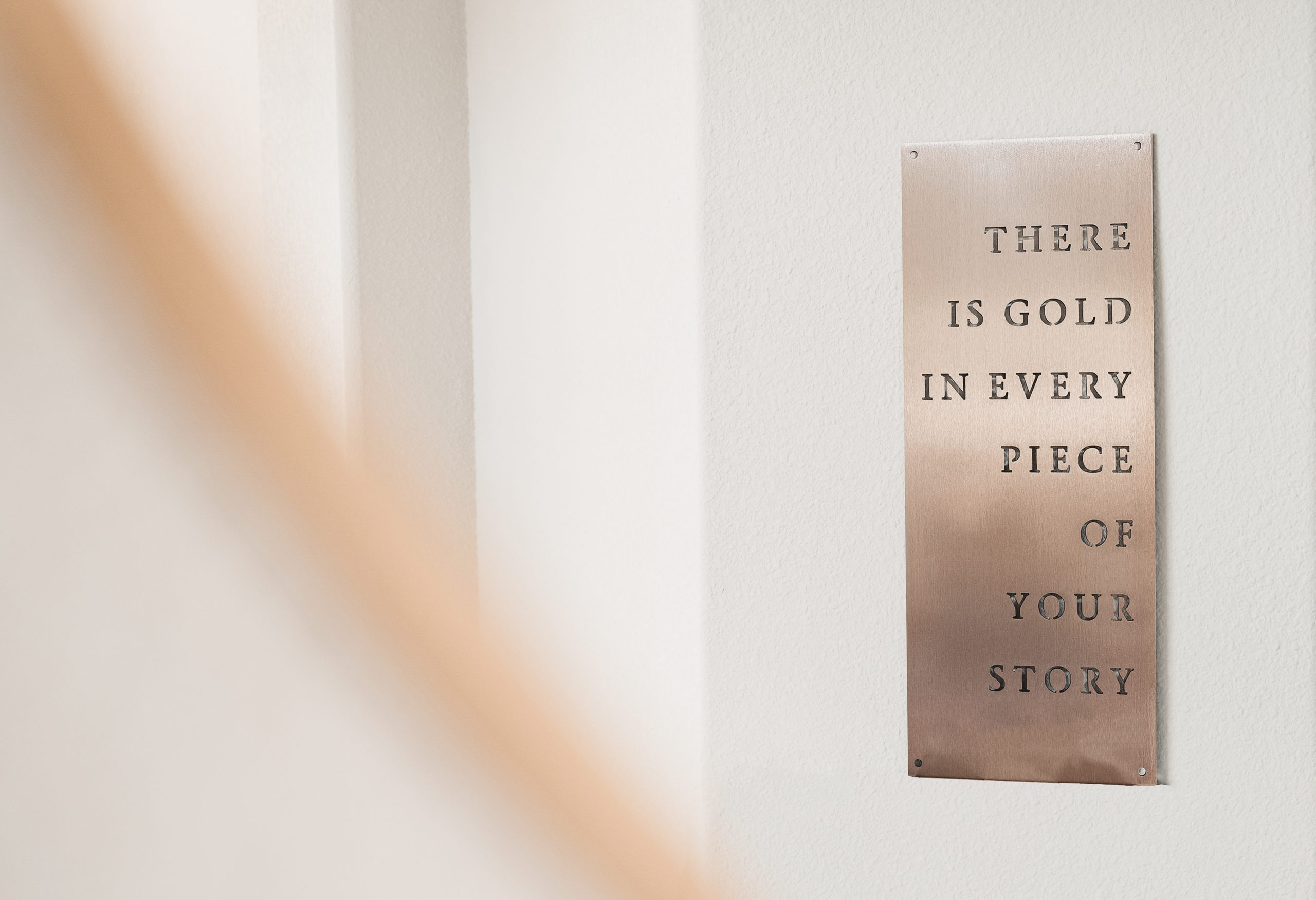 reflection of gold plaque there is gold in every piece of your story