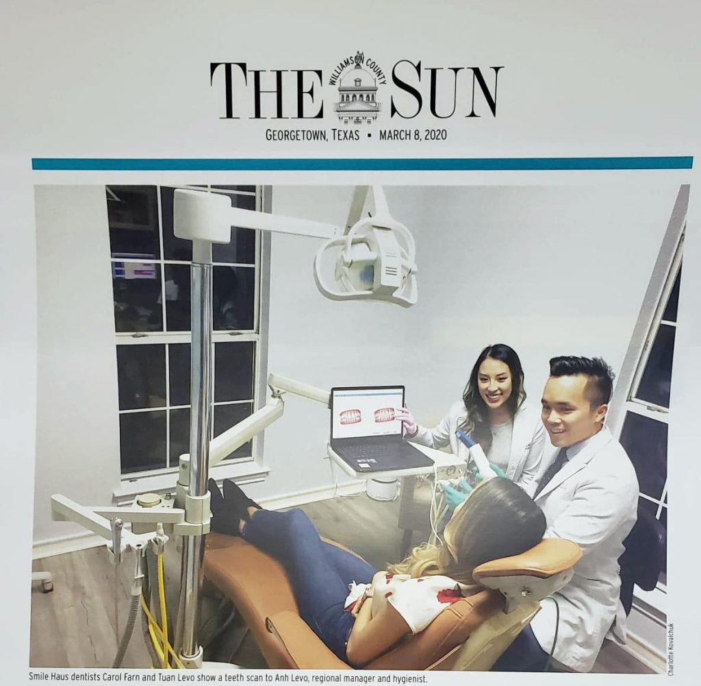 the williamson county sun georgetown texas newspaper front cover business section smile haus dentists Dr. Levo Dr. Farn discussing invisalign scan with hygienist sitting in dental chair in calming light blue room